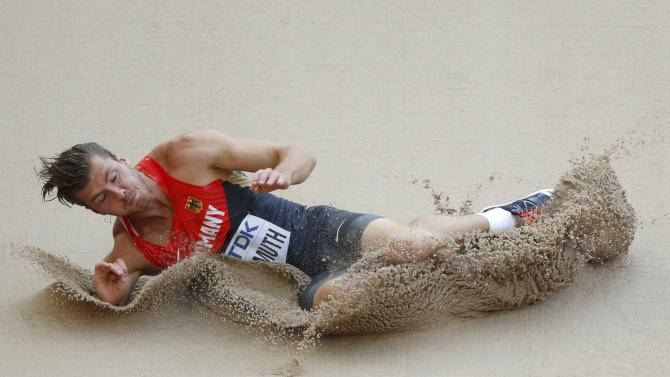 Freimuth of Germany competes in the long jump event of the men's decathlon during the 15th IAAF World Championships at the National Stadium in Beijing