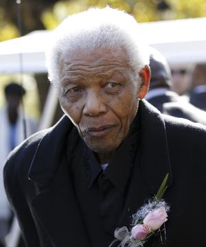 "FILE -In this June 17, 2010 file photo, former South African President, Nelson Mandela  leaves the chapel after attending the funeral of his great-granddaughter Zenani Mandela in Johannesburg, South Africa.  South African President Jacob Zuma says that former President Nelson Mandela has been admitted to hospital in Pretoria to undergo tests. Zuma issued a statement Saturday, Dec. 8, 2012 saying that Mandela is ""doing well and there is no cause for alarm."" (AP Photo/Siphiwe Sibeko, Pool, File)"