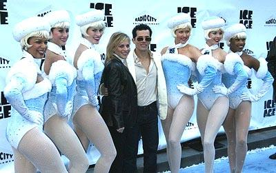 John Leguizamo and wife Justine with the Rockettes at the Radio City Music Hall premiere of Ice Age