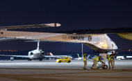 The Solar Impulse HB-SIA experimental aircraft is pulled out a hanger at Barajas airport in Madrid, Spain, Tuesday, June 5, 2012. The solar-powered airplane arrived in Madrid on May 25, 2012 from Payerne, Switzerland, and now goes on to Rabat, Morocco on its first transcontinental trip. The mission is described as the final dress rehearsal for a round-the-world flight with a new and improved aircraft in 2014. (AP Photo/Alberto Di Lolli)