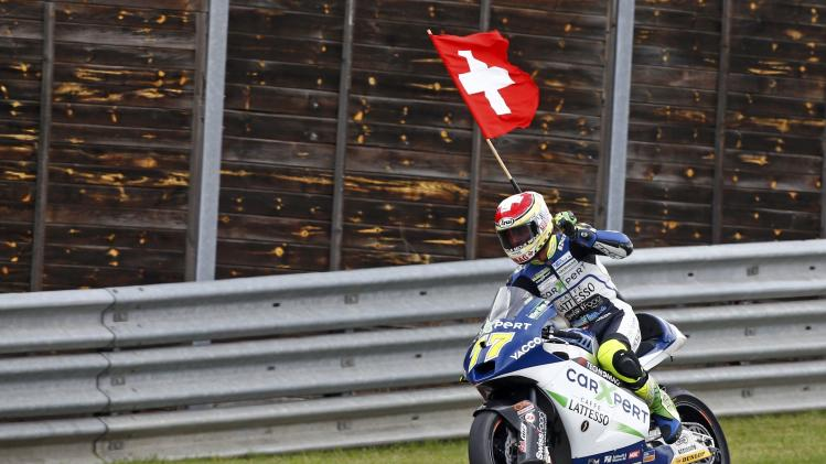 Winner Suter Moto2 rider Aegerter of Switzerland celebrates during the German Grand Prix at the Sachsenring circuit in the eastern German town of Hohenstein-Ernstthal