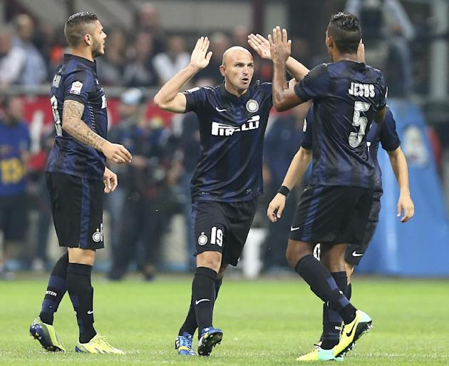 Inter Milan Argentine midfielder Esteban Cambiasso, center, celebrates with his teammates forward Mauro Icardi, left, of Argentina, and Brazilian defender Juan Jesus after scoring during the Serie A s