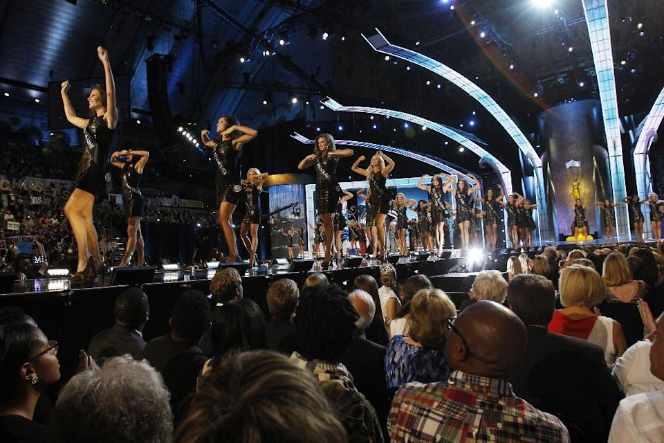 Contestants walk on the runway during the Miss America 2014 pageant, Sunday, Sept. 15, 2013, in Atlantic City, N.J. (AP Photo/Mel Evans)