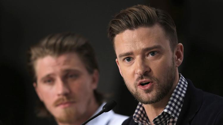 Actor Justin Timberlake, right, speaks as actor Garrett Hedlund listens during a press conference for Inside Llewyn Davis at the 66th international film festival, in Cannes, southern France, Sunday, May 19, 2013. (AP Photo/Francois Mori)