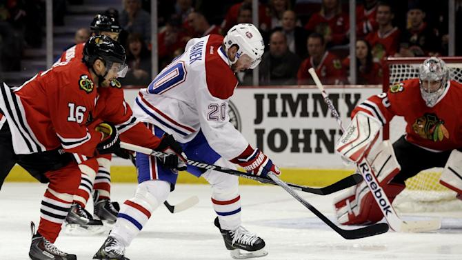 Sharp lifts Blackhawks past Canadiens in OT