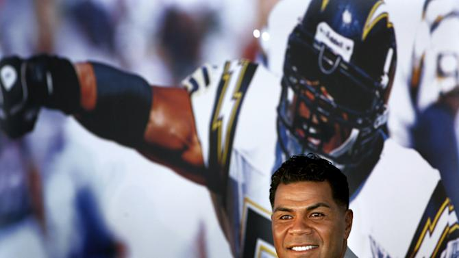 FILE - In this Aug. 14, 2006, file photo, former San Diego Chargers football player Junior Seau smiles during a news conference announcing his retirement from pro football in San Diego. Police say Seau, a former NFL star, was found dead at his home in Oceanside, Calif., Wednesday, May 2, 2012, after responding to a shooting there. He was 43. (AP Photo/Sandy Huffaker, File)
