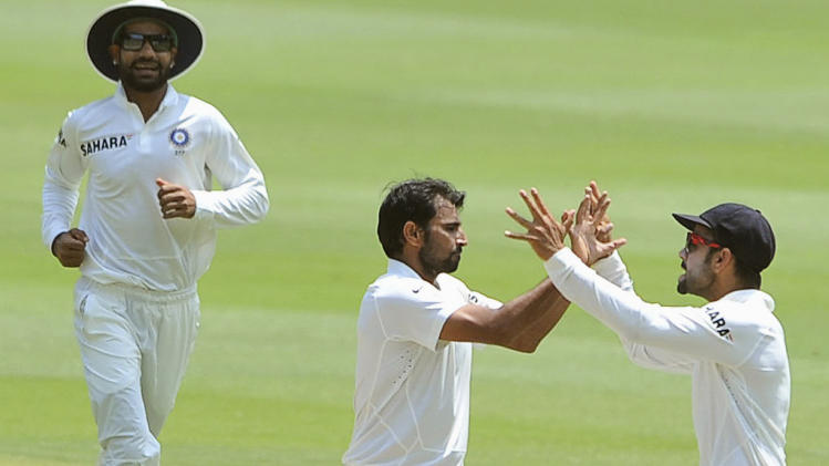 India's Mohammed Shami celebrates with teammates after bowling out South Africa's Petersen during the final day of their cricket test match in Johannesburg