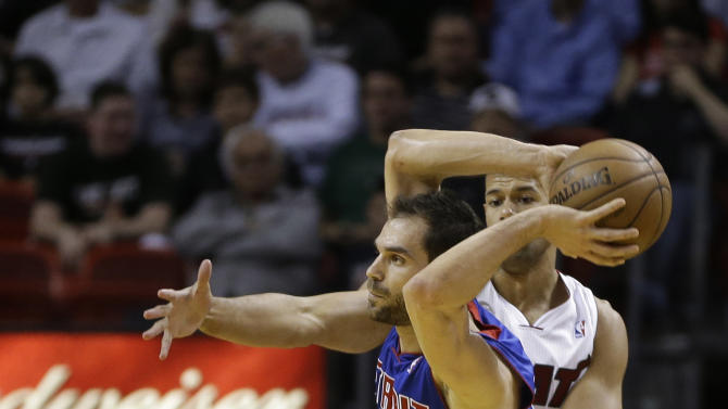Miami Heat's Shane Battier (31) tries to block Detroit Pistons' Jose Calderson (8) from shooting the ball during the first half of a NBA basketball game in Miami, Friday, March 22, 2013. (AP Photo/J Pat Carter)