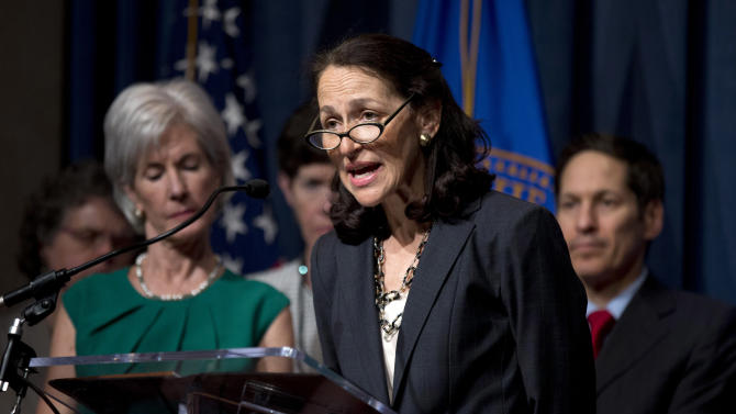 FILE - In this Wednesday, April 10, 2013 file photo, Food and Drug Administration (FDA) Commissioner Margaret Hamburg, foreground, with Health and Human Services Secretary Kathleen Sebelius, left, and others, speaks during a news conference at the Health and Humans Services (HHS) Department in Washington, to discuss the Health Department's fiscal 2014 budget. The Food and Drug Administration says it has uncovered potential safety problems at 30 specialty pharmacies that were inspected in the wake of a recent outbreak of meningitis caused by contaminated drugs. In a blog post to the FDA's website Thursday, April 11, Hamburg noted that four pharmacies initially refused to admit the agency's inspectors. In two cases the agency had to return with search warrants and U.S. marshals to complete the inspections. (AP Photo/Manuel Balce Ceneta, File)