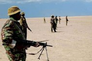 This photo taken May 3 shows Kenyan security personnel on high alert at Todonyang, along the Kenya-Ethiopia border. At least 38 people were killed when Ethiopian armed men attacked a rival community in a remote border region of north Kenya, a local official said Wednesday, warning the toll could rise