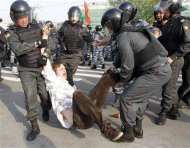 "Russian riot police detain a participant during a ""march of the million"" opposition protest in central Moscow"