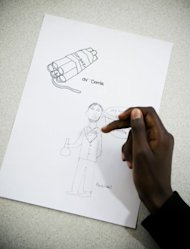 A student at Rinkeby's middle school shows his drawing of the inventor of dynamite, Alfred Nobel, during a class about the Nobel Prize on October 2. The students in the class are rewarded with a highly publicised visit by one of the laureates