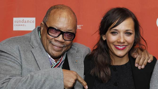 """Quincy Jones, left, and his daughter actress Rashida Jones pose at the premiere of """"Celeste and Jesse Forever"""" at the 2012 Sundance Film Festival in Park City, Utah on Friday, Jan. 20, 2012. (AP Photo/Danny Moloshok)"""