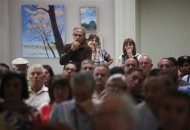 Bankia bank small shareholders take part in an assembly to discuss actions to take against the bank in Madrid