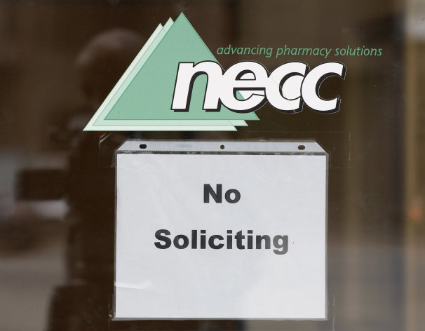 A sign requesting &quot;No Soliciting&quot; hangs on the door of New England Compounding in Framingham, Mass., Thursday, Oct. 4, 2012. An outbreak of a rare and deadly form of fungal meningitis that has killed 4 people and sickened another 26 in five states is believed to have been traced back to a steroid manufactured by the New England Compounding Center. (AP Photo/Stephan Savoia)