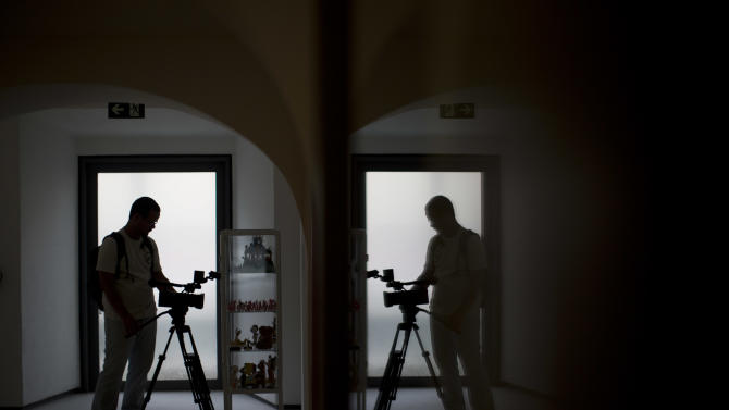A cameraman records during a media tour at the Casa Daros museum in Rio de Janeiro, Brazil, Wednesday, March 20, 2013. Local officials aiming to transform Rio de Janeiro from a sleepy cultural backwater into an art hotspot are inaugurating this week Casa Daros, a new museum that draws on one of the world's premier collections of contemporary Latin American art. Casa Daros, a 12,000-square meter (129,000-square foot) exhibition space housed in a renovated 1866 mansion, will bring to Rio some of the around 1,200 pieces acquired over the past 13 years by independently wealthy Zurich-based collector Ruth Schmidheiny. (AP Photo/Felipe Dana)