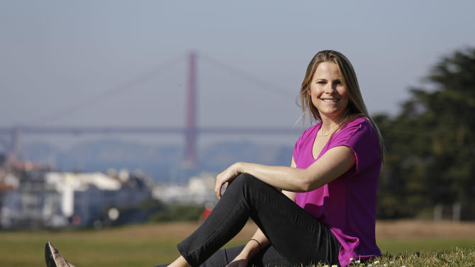 In this Thursday, Jan. 31, 2013, photo, Vanessa Loder, Founder and CEO of Akoya, LLC, poses at Fort Mason with the Golden Gate Bridge in the background in San Francisco. Loder is a former trader who left the stock market because of the recession. (AP Photo/Eric Risberg)