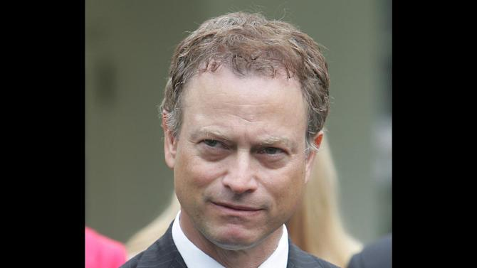 """FILE - Actor Gary Sinise listens to a media question after a meeting between President Bush and organizations that support the U.S. military in Iraq and Afghanistan in this June 26, 2006 file photo taken in the Roosevelt Room of the White House in Washington. The """"Forrest Gump"""" star helped kickoff ticket sales for """"Rockin' for the Troops"""" on Thursday May 3, 2012 at the Navistar headquarters in Lisle. (AP Photo/Ron Edmonds, File)"""