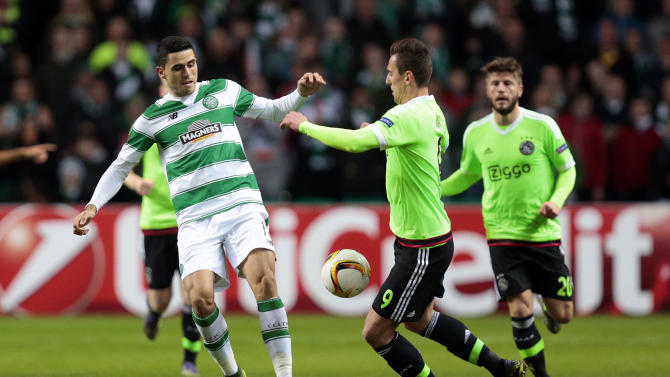 Ajax's Arkadiusz Milik in action with Celtic's Tomas Rogic