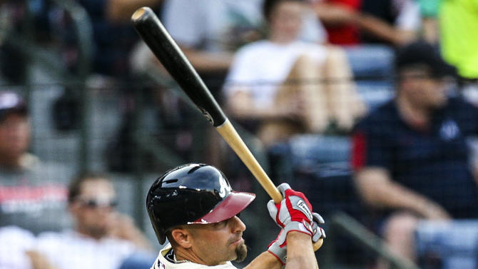 Atlanta Braves' Reed Johnson (11) hits a two-RBI double in the sixth inning of a baseball game against the Philadelphia Phillies, Sunday, Sept. 2, 2012, in Atlanta. (AP Photo/Daniel Shirey)