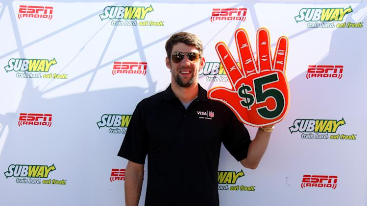 Subway Famous fan and all time gold medalist Michael Phelps seen outside of the Subway Fresh Take Green Room, on Friday, Feb. 1, 2013 in New Orleans. (Photo by Barry Brecheisen/Invision for SUBWAY/AP Images)