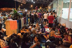 Cubans rest at the Migrations office in Penas Blancas,…