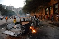 A burnt pick-up truck is seen during clashes between Egyptian protesters and riot police near the US embassy in Cairo on September 13. The US has boosted security at its embassies amid fears that more anti-American violence sparked by a film mocking Islam could erupt after Friday's Muslim prayers across the Middle East and North Africa