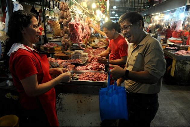 A customer uses a cloth bag while buying meat at a wet-market in Makati City, on June 20, 2013