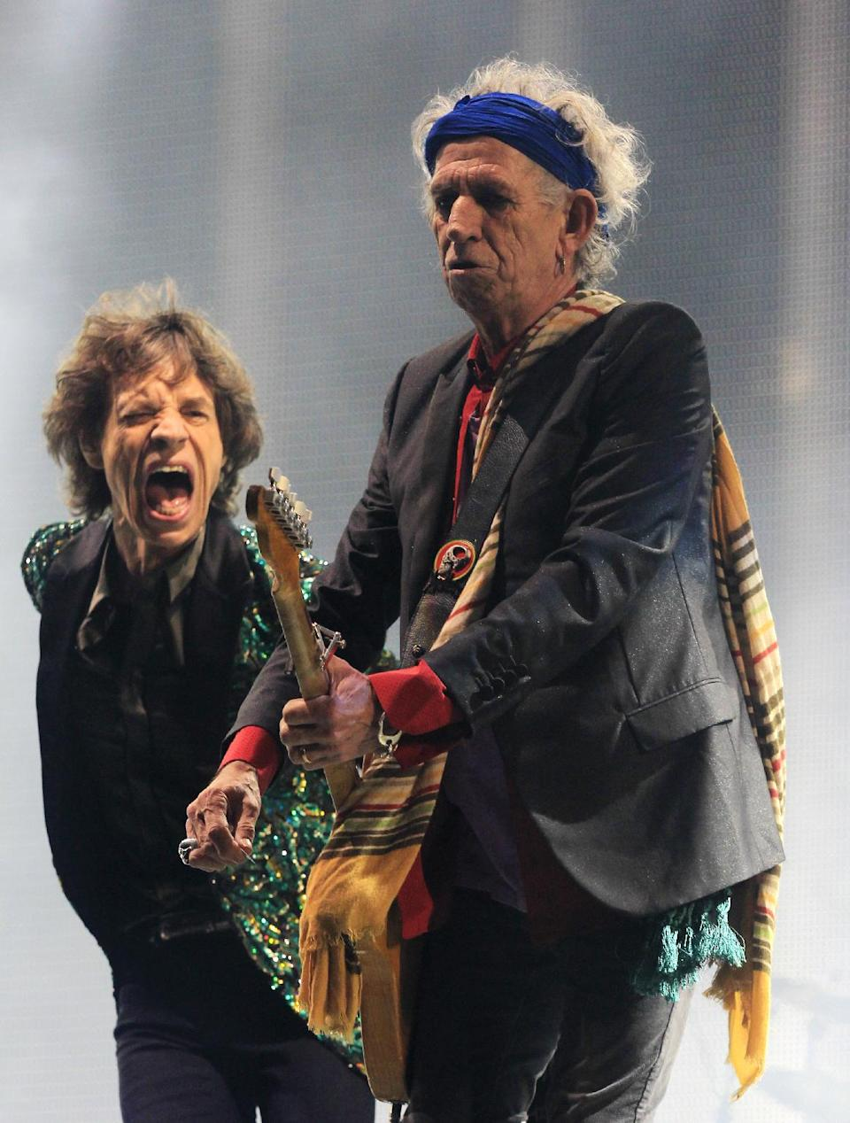 The Rolling Stones perform at Glastonbury, England on Saturday, June 29, 2013. Thousands are to enjoy the three day festival that started on Friday, June 28, 2013 with headliners Arctic Monkeys, the Rolling Stones and Mumford and Sons. (Photo by Jim Ross/Invision/AP)