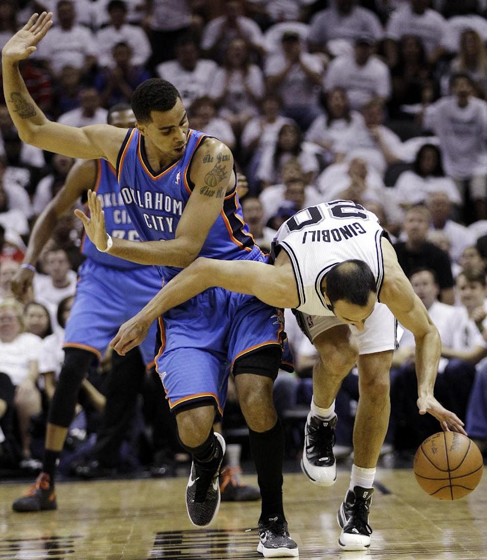 Oklahoma City Thunder shooting guard Thabo Sefolosha, left, of Switzerland, and San Antonio Spurs shooting guard Manu Ginobili (20), of Argentina, collide during the first half of Game 5 in the NBA basketball Western Conference finals, Monday, June 4, 2012, in San Antonio. (AP Photo/Eric Gay)
