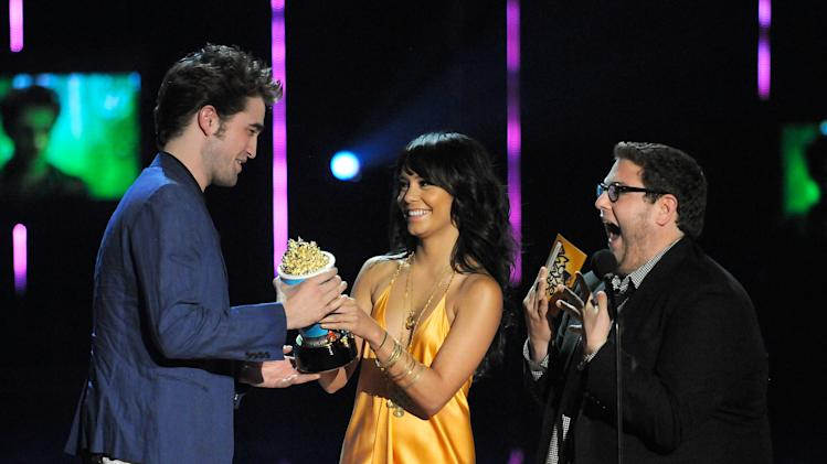 Robert Pattinson, Vanessa Hudgens and Jonah Hill onstage during the 2009 MTV Movie Awards held at the Gibson Amphitheatre on May 31, 2009 in Universal City, California.
