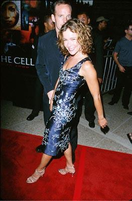 Jennifer Grey struts in front of some dude at the Loews Cineplex Century Plaza premiere of New Line's The Cell