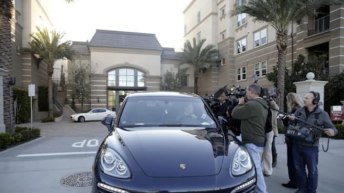 Resident Jin-Jou Lu sits in his vehicle while talking to reporters outside an upscale apartment complex, Tuesday, March 3, 2015, in Irvine, Calif. Shortly after sunrise Tuesday, federal agents swarmed the upscale apartment complex in the Orange County where authorities say a birth tourism business charged pregnant women $50,000 for lodging, food and transportation. The key draw for travelers is that the United States offers birthright citizenship. (AP Photo/Jae C. Hong)