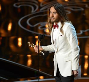 """Jared Leto accepts the award for best actor in a supporting role for """"Dallas Buyers Club"""" during the Oscars at the Dolby Theatre on Sunday, March 2, 2014, in Los Angeles. (Photo by John Shearer/Invision/AP)"""