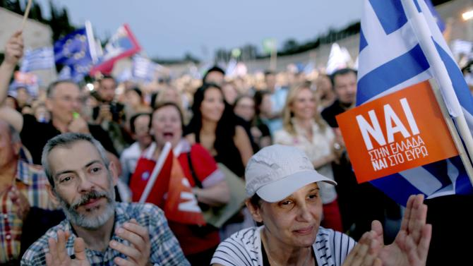 'Yes' supporters applaud during a pro-Euro rally in front the Panathenean stadium in Athens