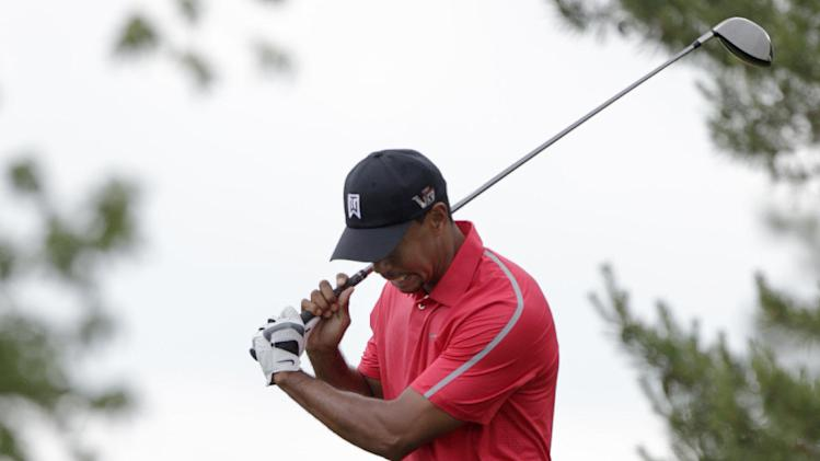 Tiger Woods reacts to hitting a bad shot on the 11th hole during the final round of the Memorial golf tournament Sunday, June 2, 2013, in Dublin, Ohio. (AP Photo/Jay LaPrete)