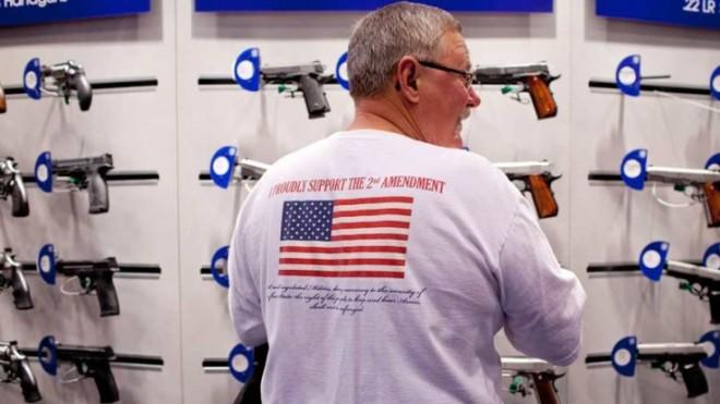 Jerry Kunzer looks at a Smith & Wesson display during the NRA's annual meeting in St. Louis on April 14.