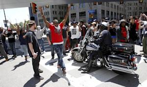 Protestors gather in a downtown intersection as a Cleveland …