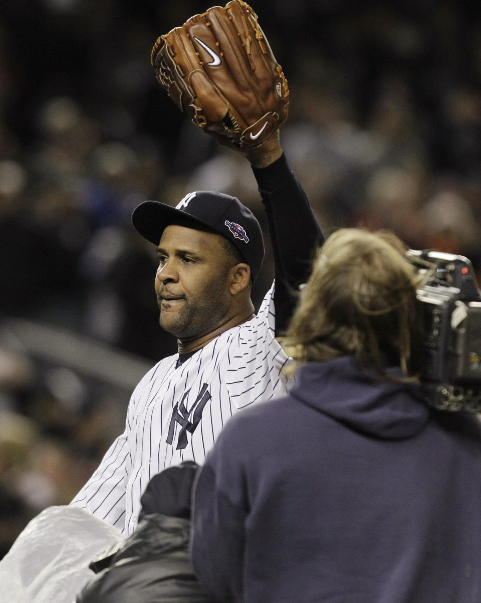 New York Yankees starting pitcher CC Sabathia waves to the fans as he leaves the field after Game 5 of the American League division baseball series against the Baltimore Orioles, Friday, Oct. 12, 2012, in New York. The Yankees won the game 3-1 and advanced to the AL championship. (AP Photo/Kathy Willens)