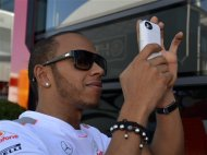 British McLaren Mercedes driver Lewis Hamilton takes photos prior to the German Formula One Grand Prix in Hockenheim, Germany, Sunday, July 22, 2012. (AP Photo/dapd, Sascha Schuermann)