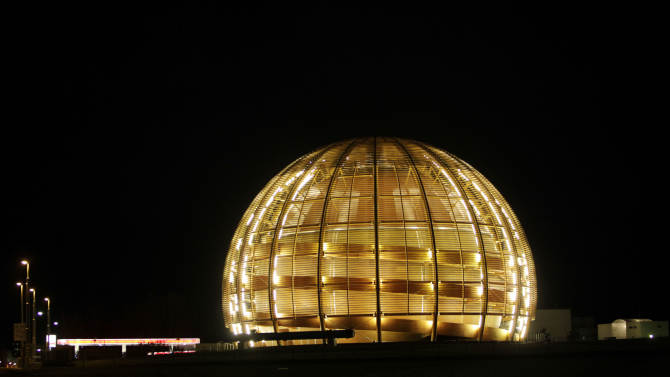 FILE - In this  Tuesday, March 30, 2010 file photo, the globe of the European Organization for Nuclear Research, CERN, is illuminated outside Geneva, Switzerland. Scientists at CERN, the world's largest physics lab, say they have clocked subatomic particles, called neutrinos, traveling faster than light, a feat that, if true, would break a fundamental pillar of science, the idea that nothing is supposed to move faster than light, at least according to Albert Einstein's special theory of relativity: The famous E (equals) mc2 equation. That stands for energy equals mass times the speed of light squared. The readings have so astounded researchers that they are asking others to independently verify the measurements before claiming an actual discovery. (AP Photo/Anja Niedringhaus)