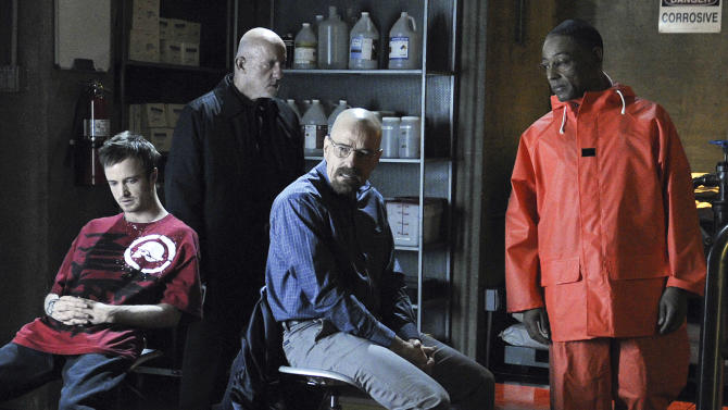 """File-In this publicity image released by AMC, from left, Aaron Paul, Jonathan Banks, Bryan Cranston and Giancarlo Esposito are shown in a scene from the premiere episode of Season 4 of  """"Breaking Bad,"""". The AMC hit television series about the methamphetamine wars in Albuquerque is helping the homeless. New Mexico's largest emergency shelter says the show recently donated boxes of clothing worn by cast members in past episodes. (AP Photo/AMC, Ursula Coyote,File)"""