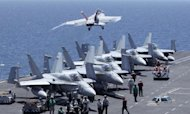 US fighters take off from the flight deck of the USS George Washington -- a Nimitz-class aircraft carrier -- during military exercises between the US and South Korea in 2010. The United States will shift the majority of its naval fleet to the Pacific by 2020 as part of a new strategic focus on Asia, Pentagon chief Leon Panetta has told a summit in Singapore