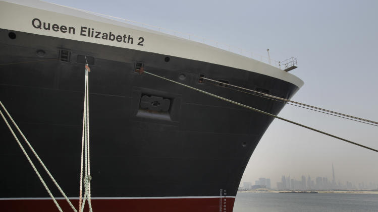 FILE - In this Monday, July 2, 2012 file photo, The Queen Elizabeth 2 is seen at dock as Istithmar World, the Dubai state investment company that owns the ship, outlined plans Monday to turn the retired cruise liner into a 300-room hotel, ending years of speculation about its fate, in Port Rashid, Dubai, United Arab Emirates. The Dubai owners of the storied passenger liner Queen Elizabeth 2 say the ship will be moved to Asia as a floating luxury hotel. (AP Photo/Kamran Jebreili, File)