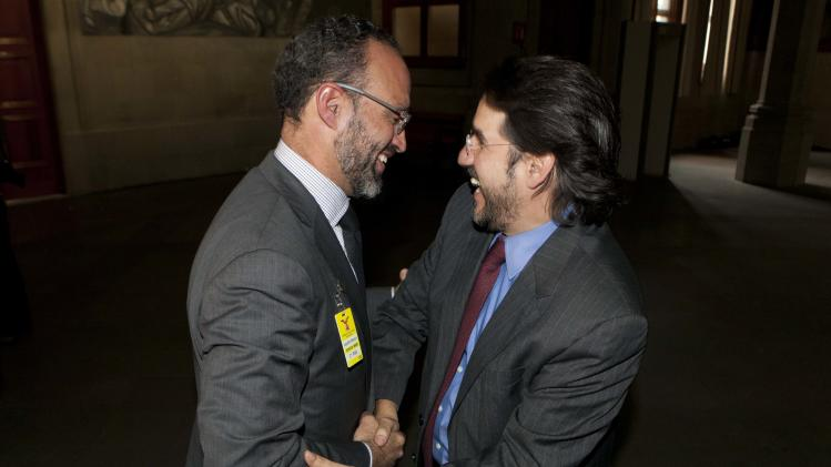 Agustin Acosta, left, lawyer of the imprisoned Frenchwoman Florence Cassez, is congratulated by an unidentified person in Mexico City, Wednesday, Jan. 23, 2013. The Mexican Supreme Court panel voted Wednesday to release Florence Cassez, who was sentenced to 60 years in prison for kidnapping. Cassez was arrested in 2005 and convicted of helping her Mexican then-boyfriend run a kidnap gang. The five-justice panel voted 3-2 to order Cassez released because of procedural and rights violations during her arrest. (AP Photo/Eduardo Verdugo)