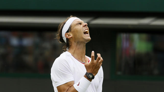 Rafael Nadal of Spain reacts as he loses a point to Steve Darcis of Belgium during their Men's first round singles match at the All England Lawn Tennis Championships in Wimbledon, London, Monday, June 24, 2013. (AP Photo/Kirsty Wigglesworth)