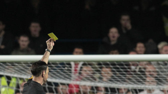 """In this Sunday, Oct. 28, 2012, Chelsea's Fernando Torres, right, is shown a second yellow card by referee Mark Clattenburg during their English Premier League soccer match against Manchester United at Stamford Bridge, London. Chelsea accused referee Mark Clattenburg of using """"inappropriate language"""" at two players during Sunday's Premier League match against Manchester United, and lodged an official complaint with the Football Association. Clattenburg sent off two Chelsea players in the 3-2 loss to United at Stamford Bridge and allowed a contentious late winning goal to striker Javier Hernandez, who appeared to be offside when he scored. (AP Photo/Sang Tan)"""