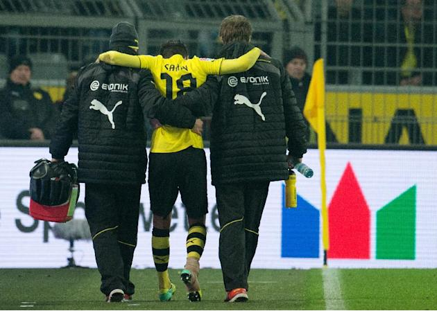 In this picture taken Saturday  Dec. 7, 2013, Dortmund's Nuri Sahin is carried off the field after an injury during the Bundesliga soccer match between Borussia Dortmund and Bayer 04 Leverkusen at