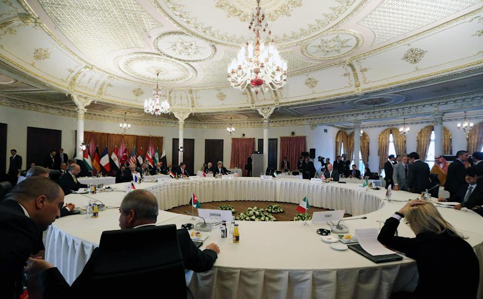 U.S. Secretary of State John Kerry, rear center, and some of the Friends of Syria group during a meeting in Istanbul, Turkey,  Saturday, April 20, 2013. Kerry is expected to announce a significant expansion of non-lethal aid to the Syrian opposition.(AP Photo/Hakan Goktepe, Pool)