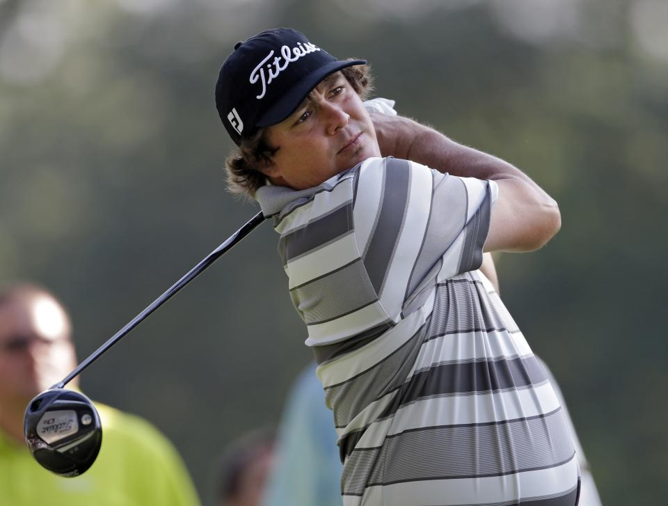 Jason Dufner watches his tee shot on the 11th hole during the first round of the Bridgestone Invitational golf tournament Thursday, Aug. 1, 2013 at Firestone Country Club in Akron, Ohio. (AP Photo/Mark Duncan)